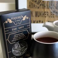 Biodegradable pyramid Earl Grey tea bags of gorgeous whole leaf black tea from Sri Lanka blended with organic Italian Bergamot Oil. PekoeBrew Tea Company