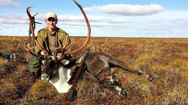 Posing with caribou