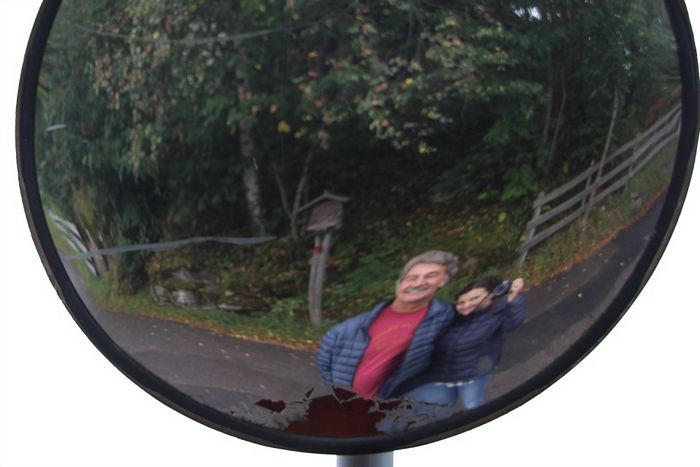 Dan and Rudi (Happy Mango owners) looking into a traffic mirror in Italy.