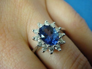 1.30 CT T.W. TANZANITE AND HALO DIAMONDS ROYAL ENGAGEMENT RING