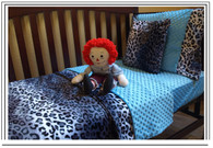 Shown: snow leopard with blue turquoise trim and sheet (you choose colors)