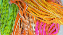"Hareline Tiger Barred Rabbit Strips- 1/4"" Magnum (Left to Right- Black Barred Chartreuse Tipped Green Chartreuse, Black Barred White Tipped Hot Orange, Black Barred Hot Orange Tipped Flo. Hot Pink, Black Barred Yellow Tipped Hot Orange)"