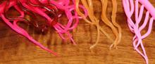 Hareline Mini Squiggle Worms (Left to Right- Flo. Fuchsia, Sangria, Peach, Bubble Gum)