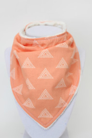 Peach Triangles bandana bib with ivory minky back.