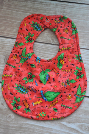 Bugs Lunch in coral classic bib