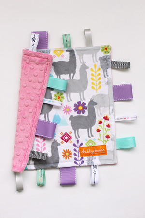 Small Llamas tag blanket with pink minky back.