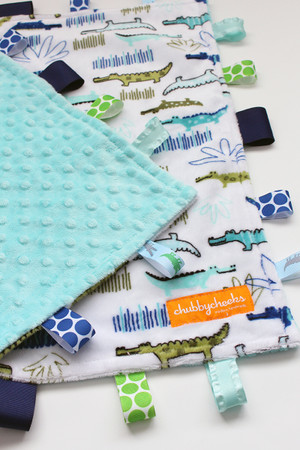 Large Alligators tag blanket with light teal minky back.