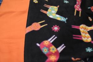 Llama with orange backing