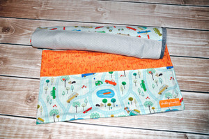 """Quilted blanket with grey minky back. Crib size - approx. 37""""w x 40""""."""