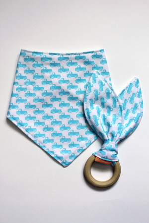 Blue Trucks gift set, includes a bandana bib with organic bamboo back and a matching organic wooden teether.