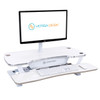 White Single Monitor Arm Mount | Attached With Grommet Hole | Monitor Attached | VersaDesk Power Pro Sit-to-Stand Desk Riser