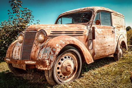 Classic Renault Juvaquatre waiting to be restored including rust treatment followed by rust proofing