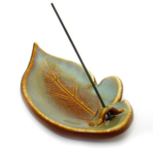 "Leaf-shaped Holders Add a touch of nature to your home or workspace with our playful Leaf-shaped Incense Holders. Each elegant piece is hand-thrown and glazed, ensuring that no two are alike. A single hole in the ""stem"" of this ceramic leaf holds your incense stick in place, while the leaf's face provides a flat surface for burning incense cones.  Made in Japan"