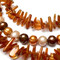 Closeup of citrine, shell and pearls