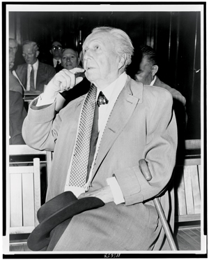 frank-lloyd-wright-sitting-on-bench.jpg