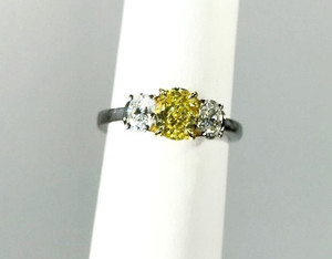 Contemporary Fancy Intense Yellow and White Diamond 3 Stone Ring 18kt