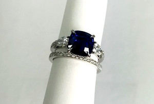 Modern 18kt Sapphire 4.17 carat & Diamond .82 ctw. 3 Stone Ring with Wedding Band