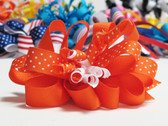 Orange twirl polka dot hair bow w french clip