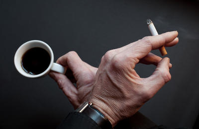 Coffee and Cigarette in hands