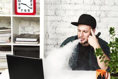cloudchaser vaping at desk