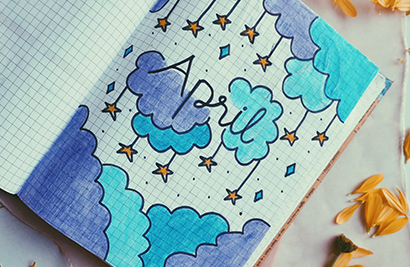 april notebook with clouds