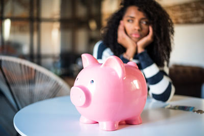 frustrated-woman-with-piggy-bank