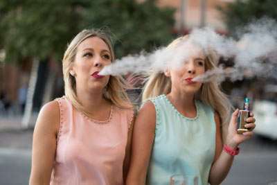 Vapers using e-cigarettes on holiday