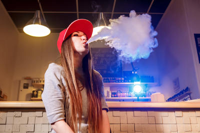 Female Vaper Blowing Clouds