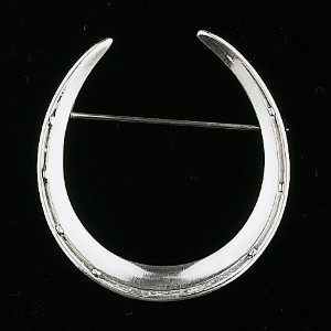"A classic sterling silver horseshoe pin from a circa 1930 mold. 1 5/16"" wide x 1 1/2"" tall."