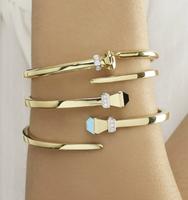 14k Yellow Gold Horseshoe Nail Bangle Bracelet with Onyx and Diamonds
