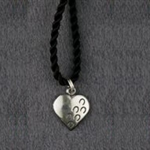 "Sterling silver ""Hoof Prints on Your Heart"" charm pendant."