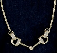 "14k gold bit necklace with .18ctw diamonds. Moveable bit ends. 17"" length."