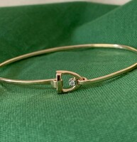 14k Gold Tiny Stirrup Bangle Bracelet with Center Diamond.