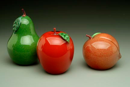 "Jade Green Pear, hand-sculpted glass, with torchworked green  leaf and stem. (Shown with Red Blush Apple and Peach), 4"" tall."