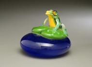 "Green Frog on lily pad, over ""water"" background...all hand-sculpted solid glass, with torchwork coloration accents and clear encased lifelike murrine eyes!"