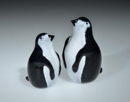 hand-sculpted glass Penguins, with torchwork eyes and beak.