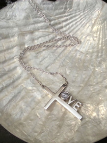 "Love Cross™ NORTH STAR in solid sterling silver on an 18"" silver chain.   Pendant Size: 1-1/8"" x 3/4""  Made in USA."