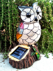 Owl solar lights has a warm white LED.