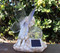 Solar powered fairy statue for outdoor garden.