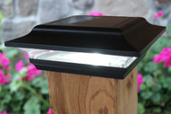 Black 5x5 solar post cap lights are made from aluminum.