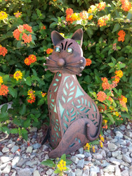 The cat solar light stands 16 inches tall and is made from rustic bronze metal.