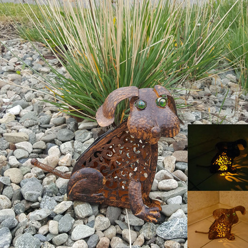 Dog solar light is made from antique bronze metal, and has an Amber LED that lights up at night.