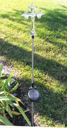 Cross color changing solar lights have an elegant scroll design on the 6.8 Inch solar Cross, and stand over 32 inches high.
