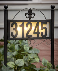 Solar address light is made from sturdy metal with a Black Finish and 4 Warm White LED bulbs.