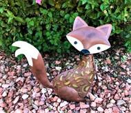"Fox solar statue is a large solar animal garden light sized at 15"" H x 15"" L x 5"" W."