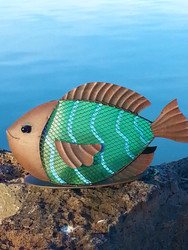 Fish solar light is made from rustic brown metal and PVC film.