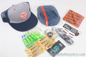 Interbike SWAG Lot: Abus Caps - Put Up or Shut UP Top Cap - Chain Lube - Chamois Cream - 25pc