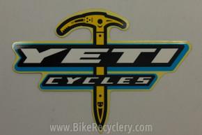 """1990's YETI Cycles Sticker: Ice Axe Logo 5 3/4"""" x 4"""" Teal White"""