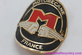 Motobecane Grand Jubilee / Record Headbadge: Round w/ Wings, Gold/Black/Red - 1970's - Early 1980's  (MINT)