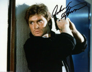 ANDREW STEVENS AUTOGRAPHED SIGNED 8X10 COLOR PRESS PHOTO WITH GUN